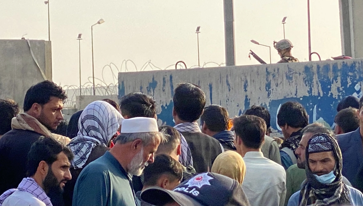 Chaos and violence as crowds keep growing outside Kabul airport