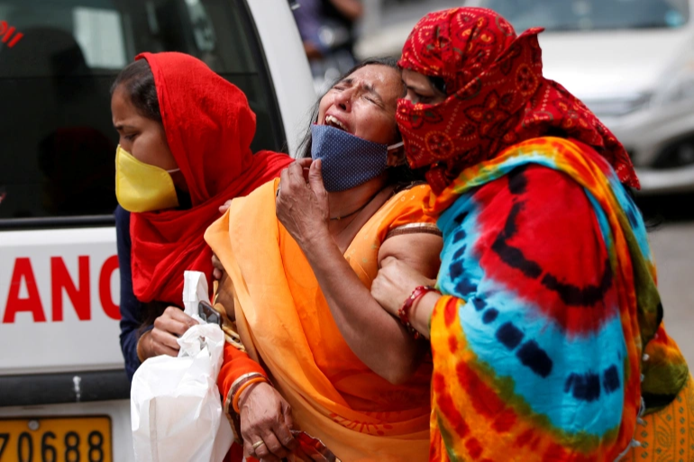 India hits new grim record with 3,689 COVID-19 deaths in one day