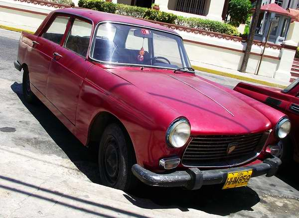 Peugeot 404 in Cuba | A worn out Peugeot 404 in the Main Str… | Flickr