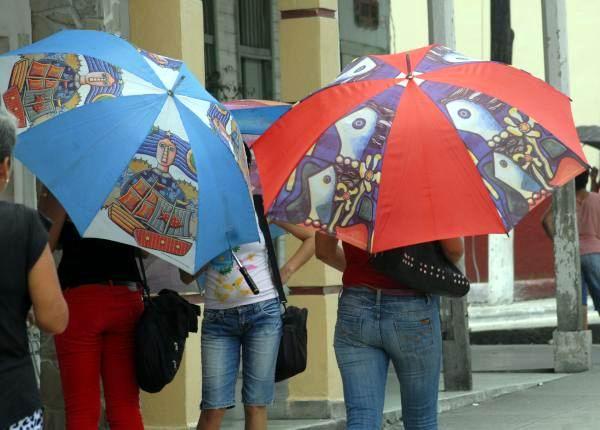 Las sombrillas, utilidad y belleza en las calles cubanas