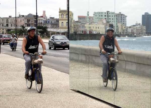 Ciclista transitando por el Malecón frente al espejo de la Bienal