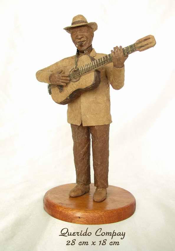 Escultura de tabaco dedicada a  Compay Segundo de la serie Famosos Fumadores. Autor Janio Núñez