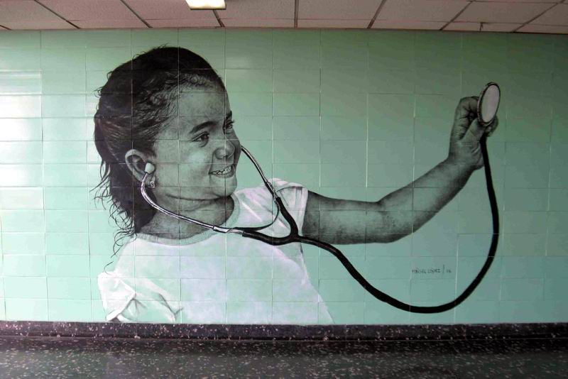 Infantile Faces of the City. Urban mural by Maisel López