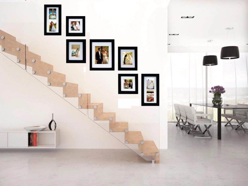 Formas novedosas para colgar tus cuadros fotos for Cuadros para escaleras
