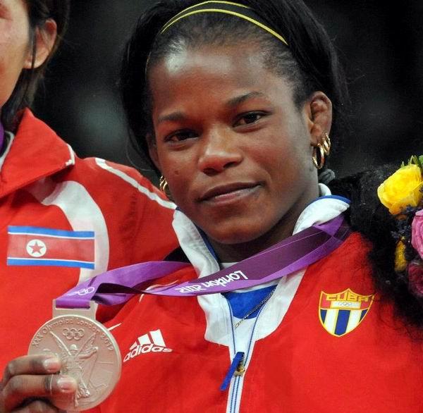 La judoca cubana Yanet Bermoy dio a Cuba este domingo su primera medalla en los Juegos Olímpicos de Londres tras caer en la final de los 52 kilogramos por punto de oro frente a Am Kum Ae, de Corea del Norte. Foto: Ricardo López Hevia