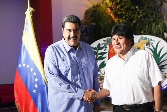 Evo Morales en tierras venezolanas y es recibido por Nicol�s Maduro