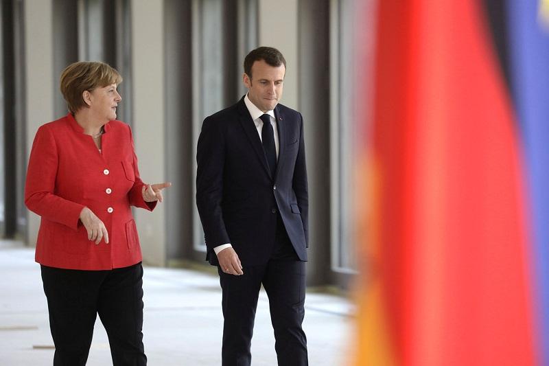 Abogan Merkel y Macron por reforzar pacto nuclear con Irán